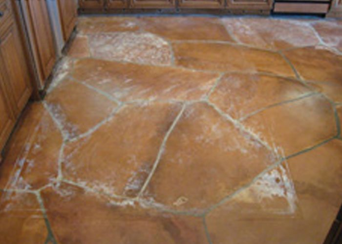 View of water damage on flagstone kitchen floor