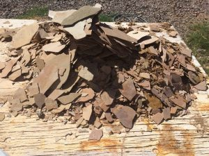 Pile of flagstone rubble   Flagstone Exterior   Photo Gallery   Baker's Travertine Power Clean