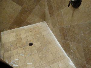 Cleaning & scraping travertine shower in Scottsdale   Showers & Vanities   Interior Gallery   Baker's Travertine Power Clean