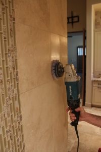 Buffing travertine shower wall in Gilbert | Showers & Vanities | Interior Gallery | Baker's Travertine Power Clean