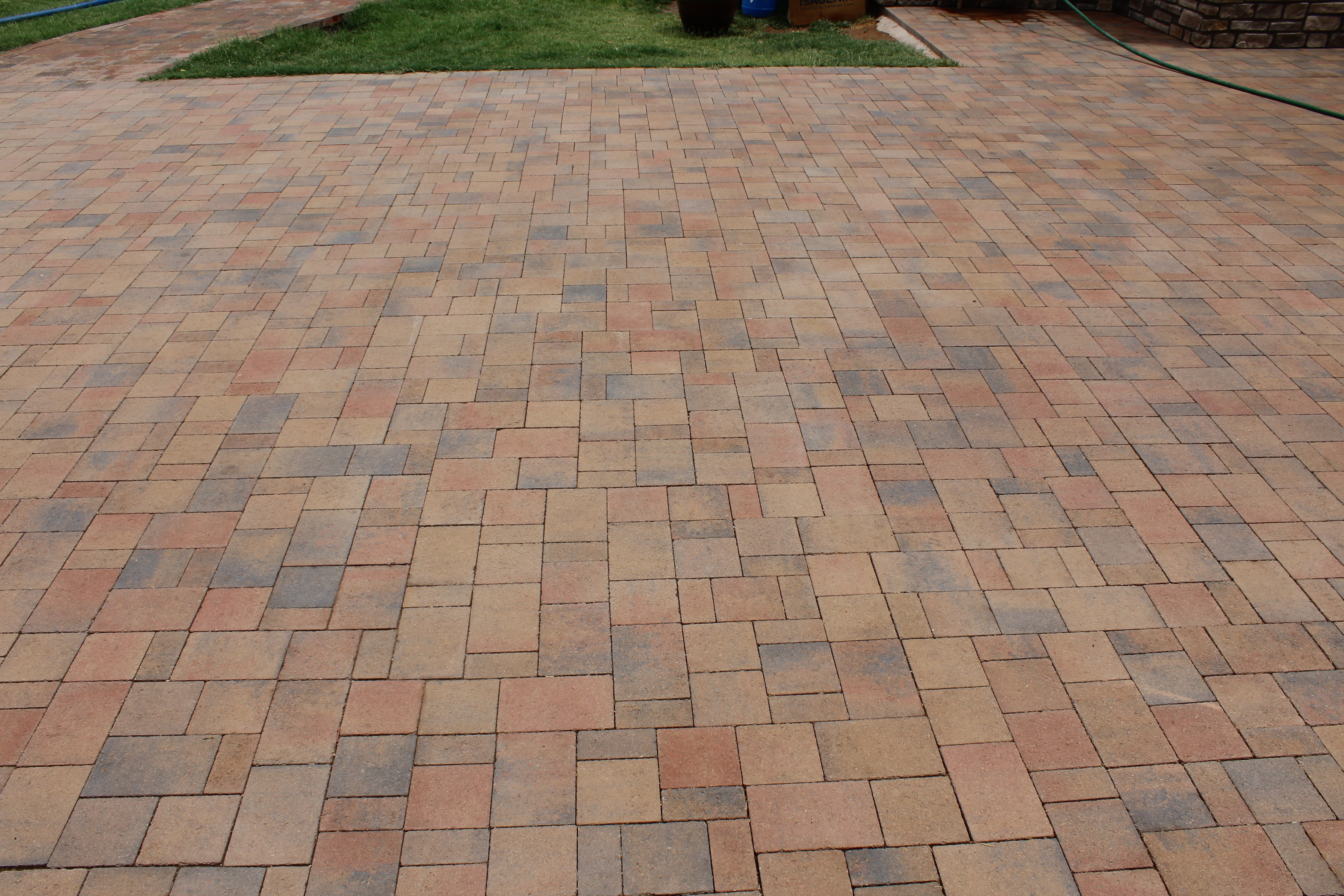 Image shows vibrant color of concrete paver after treatment